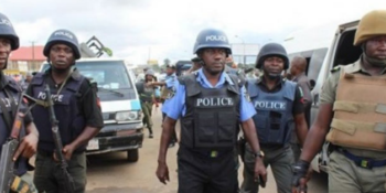 File photo: Policemen at a crime scene