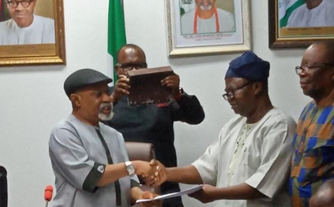 The Minister of Labour and Employment, Senator Chris Ngige shakes hands with the President of the Academic Staff Union of Universities (ASUU)