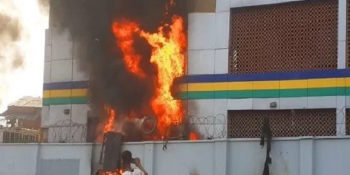 Burning police station