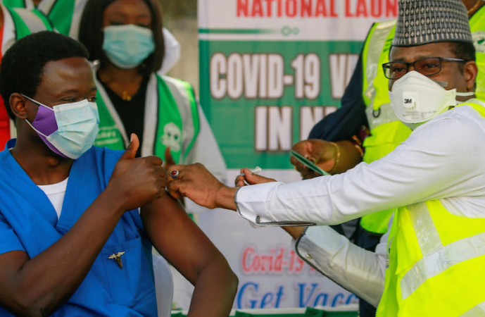 Dr Ngong Cyprian receives his first dose of the Oxford/AstraZeneca coronavirus disease (COVID-19) vaccine from Dr Faisal Shuaib, Executive Director and Chief Executive Officer of the National Primary Health Care Development Agency, at the National hospital in Abuja, Nigeria, March 5, 2021.