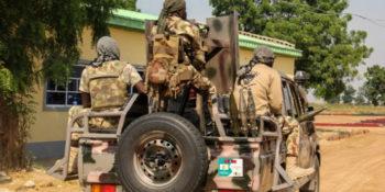 Armed bandits in army uniform
